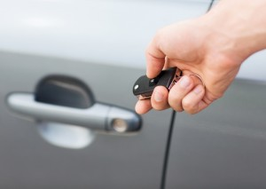 5872660-man-with-car-key-outside